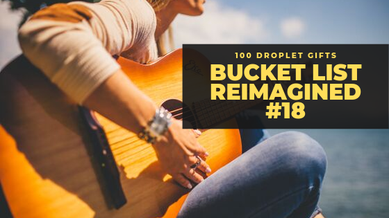 girl in blue jeans with a guitar by the water, bucket list reimagined #18, 100 droplet gifts, getting my song back, by the rivers of Babylon, songs in Babylon, music, harps